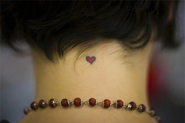 girls tattoos on neck. Small heart tattoos perhaps