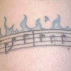 Flaming Music Note Armband Tattoo