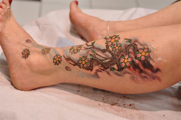cherry blossom branch calf tattoo Cherry Blossom Branch Calf Tattoo