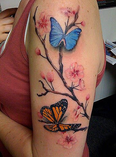 butterflies tattoo. cherry tree blossom tattoo.