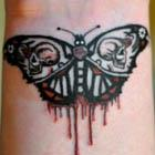 Evil Moth Tattoo